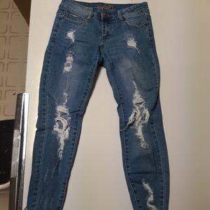 Medium wash highly distressed skinny jeans